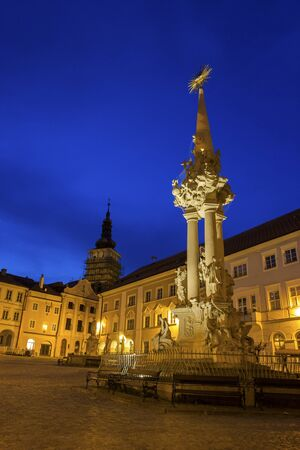 Historic Square with Holy Trinity Statue and Church of St. Wenceslas in the background in Mikulov in Czech Republic