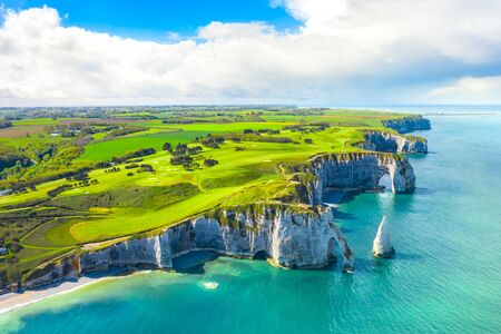 Photo for Picturesque panoramic landscape on the cliffs of Etretat. Natural amazing cliffs. Etretat, Normandy, France, La Manche or English Channel. Coast of the Pays de Caux area in sunny summer day. France - Royalty Free Image