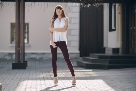 beautiful young model walks the city in summer