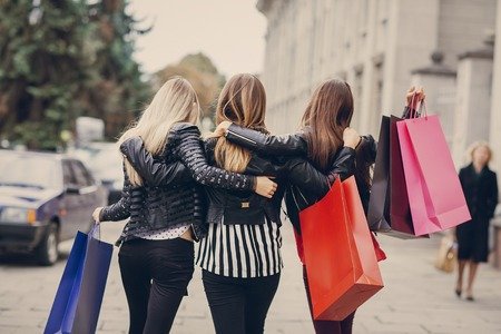 Foto de woman with returns from shopping with colored bags fashion - Imagen libre de derechos