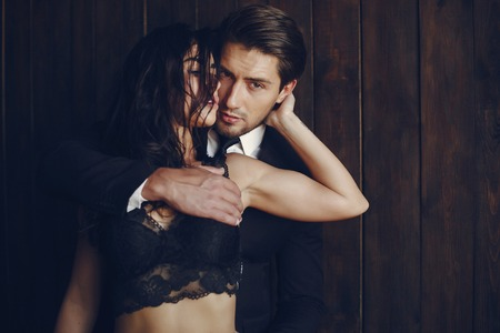 Photo pour Sexy couple at home - image libre de droit