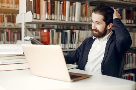 Photo pour Handsome guy study at the library - image libre de droit