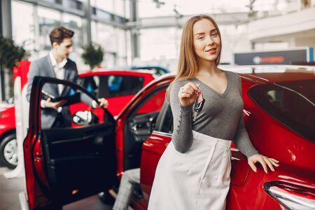 Photo pour Two stylish woman in a car salon - image libre de droit