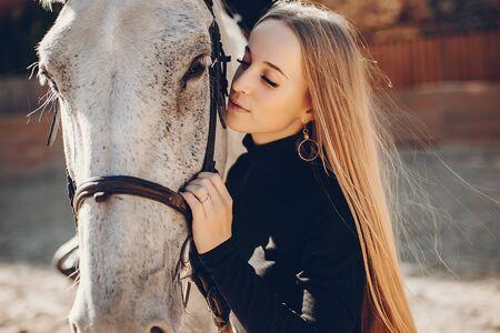 Photo pour Elegants girl with a horse in a ranch - image libre de droit