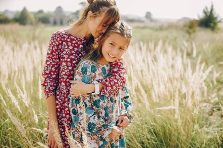 Cute and stylish family in a summer field