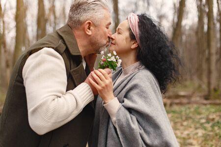 Photo pour Elegant adult couple in a spring forest - image libre de droit