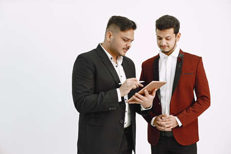 Photo for Two men in official costumes discussing something isolated - Royalty Free Image