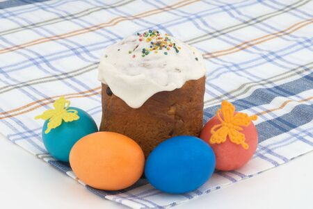 Easter cake and Easter eggs on background. Tradition decorative bread. Selective focus