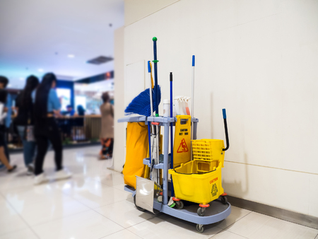 Foto de Cleaning tools cart wait for cleaning.Bucket and set of cleaning equipment in the Department store - Imagen libre de derechos