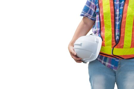 Photo pour Engineering woman holding a white safety helmet standing on an isolated background. - image libre de droit