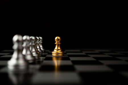 Photo for Golden Chess pawn standing in front of other chess, Concept of a leader must have courage and challenge in the competition, leadership and business vision for a win in business games - Royalty Free Image