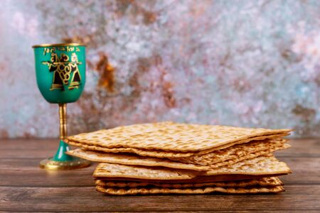 Photo pour Jewish holiday table for Passover with matzah and metalic cup of kosher wine - image libre de droit