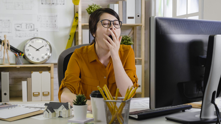 Photo for sleepy tired overworked hardworking assistant architect yawning with close eyes cover mouth want to sleep. - Royalty Free Image