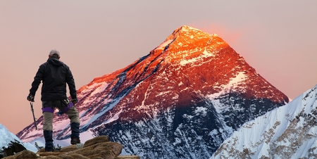 Evening colored view of Mount Everest from Gokyo valley with tourist on the way to Everest base camp, Sagarmatha national park, Khumbu valley, Khumbu valley, Sagarmatha national park, Nepal