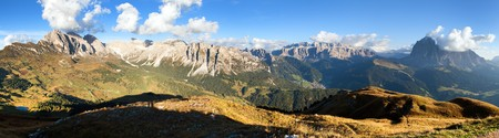 Evening panoramic view of Geislergruppe or Gruppo delle Odle and Sella gruppe or Gruppo di Sella, Alps Dolomites mountains, Dolomiti, Italy
