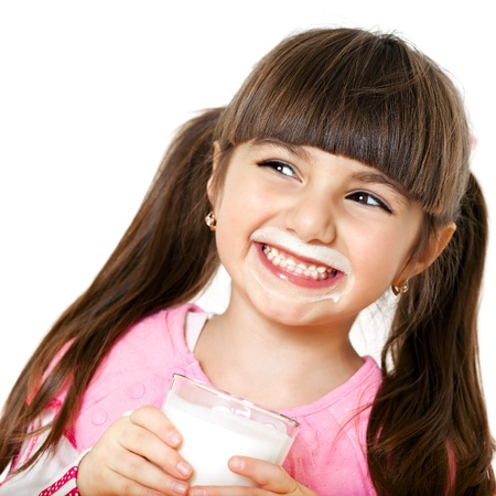 beautiful smiling girl with a glass of milk