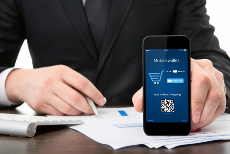 businessman at the office holding a touch phone with mobile wallet onlain shopping on the screen