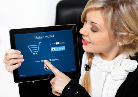 businesswoman holding a tablet with mobile wallet onlain shopping on the screen