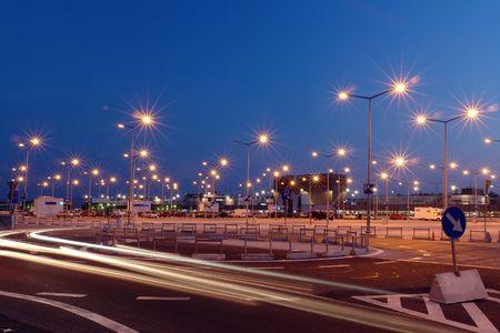 Foto per Lanterns at shopping mall parking lot illuminated at night - Immagine Royalty Free