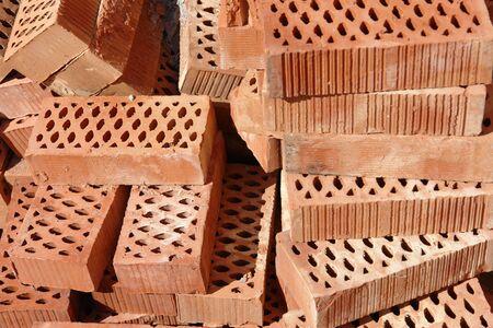 Pile of red cavity bricks