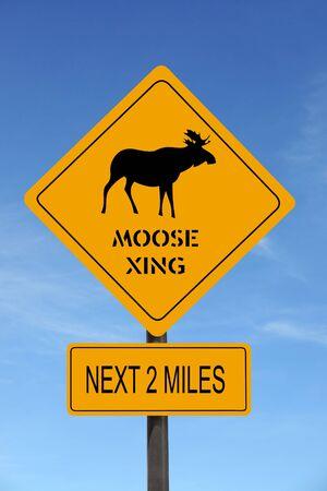 Moose Xing warning roadsign over blue sky