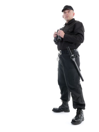 Security man wearing black uniform standing with binoculars, shot on white