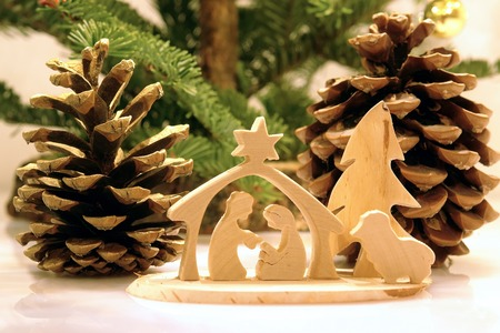 Christmas crib figures curved from wood representing Holy Family and animals