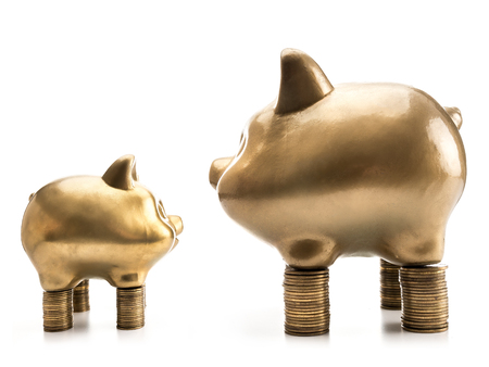 Photo pour Two big and small golden piggybanks standing opposite each other on piles of money on white background - image libre de droit