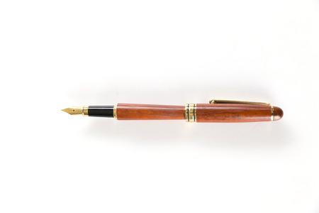 brown vintage fountain pen on white background