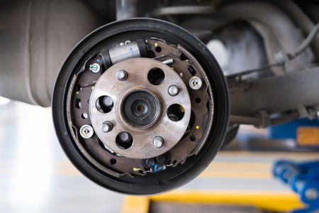 Photo pour detail of car suspension & bearing of wheel hub in auto service maintenance. Car lift up by hydraulic, waiting for tire replacement in garage. punched wheel concept - image libre de droit