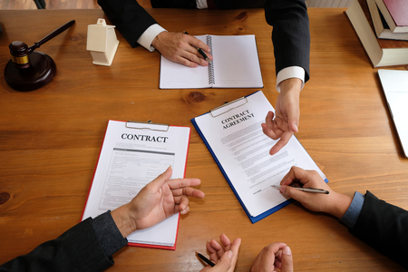 businessman consulting lawyer & signing contract agreement. team meeting at law firm. estate law & property auction concept