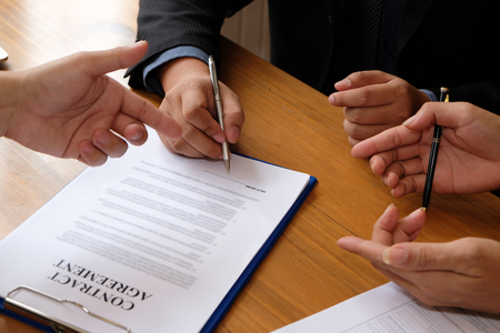 businessman consulting lawyer & signing contract agreement. team meeting at law firm
