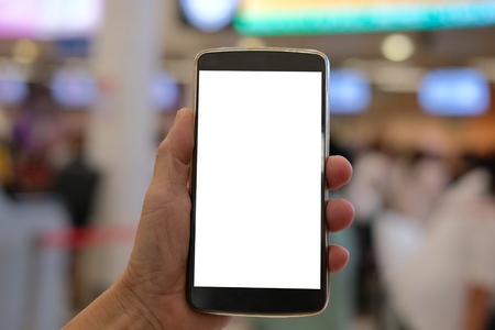 Photo for hand holding mobile smart phone at airport  terminal - Royalty Free Image