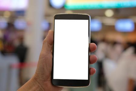 Photo pour hand holding mobile smart phone at airport  terminal - image libre de droit