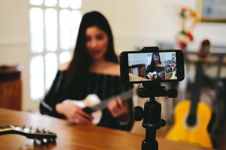 Photo for blogger live broadcasting music instrument tutorial on social media. vlogger recording online vlog video. influencer marketing - Royalty Free Image