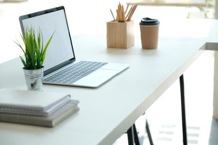 Foto de computer tablet pencil coffee cup on office desk. workplace co-working space interior - Imagen libre de derechos