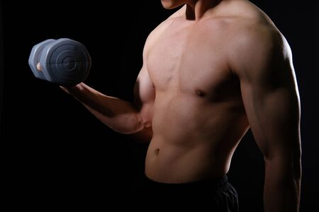 Photo for portrait of athletic muscular bodybuilder man with naked torso six pack abs working out with dumbbell. fitness sport exercise concept - Royalty Free Image
