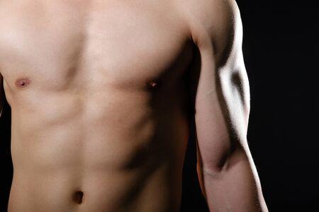 Photo pour portrait of athletic muscular bodybuilder man with naked torso six pack abs. fitness workout concept - image libre de droit
