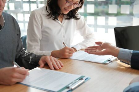 Photo pour couple buying renting house car signing mortgage insurance purchase order contract with realtor real estate agent. architect designer closing dealing with customer - image libre de droit