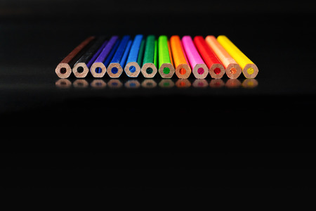Foto de Diversity concept. row of mix color pencil on black background with text Diversity, Ethnicity, Equality, Age, Sexual Orientation - Imagen libre de derechos
