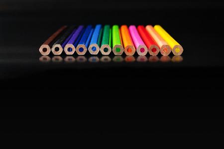 Photo pour Diversity concept. row of mix color pencil on black background with text Diversity, Ethnicity, Equality, Age, Sexual Orientation - image libre de droit