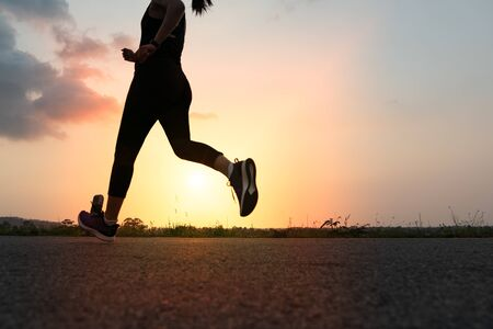 Photo for sport woman running on a road. Fitness woman training at sunset - Royalty Free Image