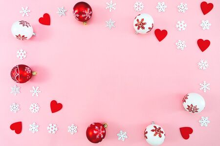 Photo pour Christmas composition. Christmas balls, red heart and snowflakes decorations on pink background. Flat lay, top view, copy space - image libre de droit
