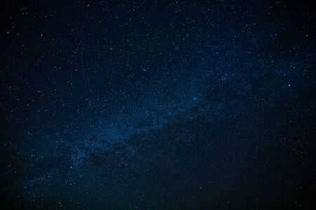 Photo for Milky way upon starry dark blue sky. - Royalty Free Image