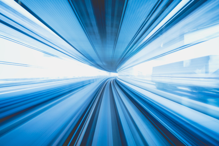 Motion blur of train moving inside tunnel with daylight in tokyo, Japan, blue color