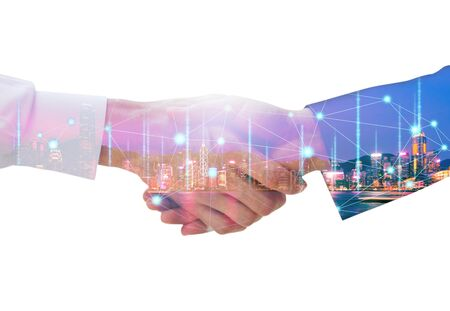 Photo pour Professional teamwork and network connection technology concept, Double exposure of arab Business man handshake to his business partner with digital graphic against city night background in meeting - image libre de droit
