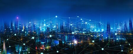 Foto de Wireless network and Connection technology concept with Bangkok city background at night in Thailand, panorama view - Imagen libre de derechos