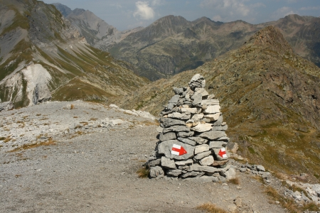 cairn with painted red arrows in Rhone-Alpes