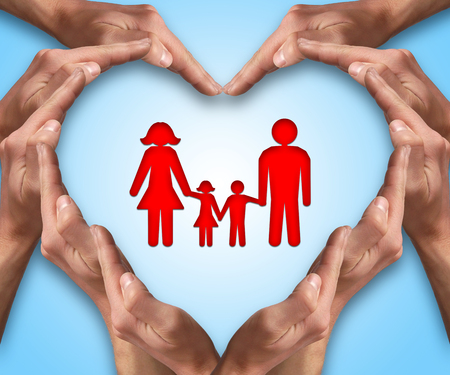 Photo pour Hands make heart shape with a family in center. Love and protection concept. Family insurance - image libre de droit