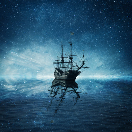 Photo pour A ghost pirate ship floating on a cold dark blue sea landscape with a starry night sky background and water reflection. - image libre de droit